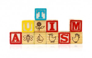 Stacked blocks spelling autism on white background