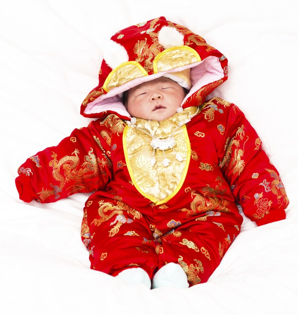 New born baby wears the Traditional Chinese attire.