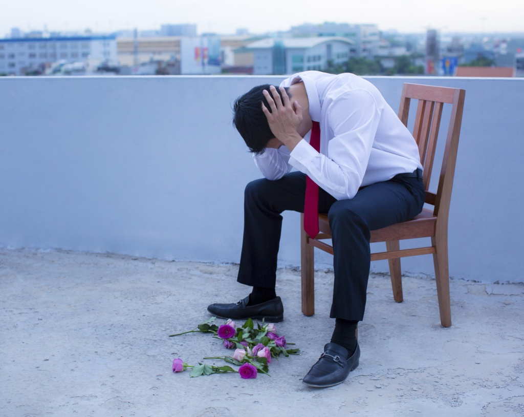 Blue tone, wooden chair, shot from a roof, Vietnam, roses laying on ground, red tie, in a suit