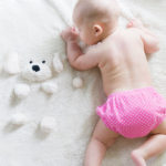 bathe a newborn - baby on towel