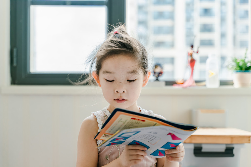 girl reading books